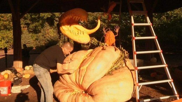 Man carving pumpkin