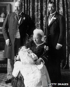 Christening of Prince Edward Albert of York (later King Edward VIII), with Duke of York (later King George V) on the right; the Prince of Wales (later Edward VII) on the left, while Queen Victoria is holding the infant