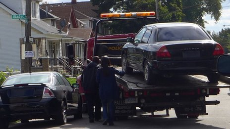 A car is towed in Detroit, Michigan