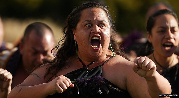 Maori performers give a traditional welcome to a visiting head of state