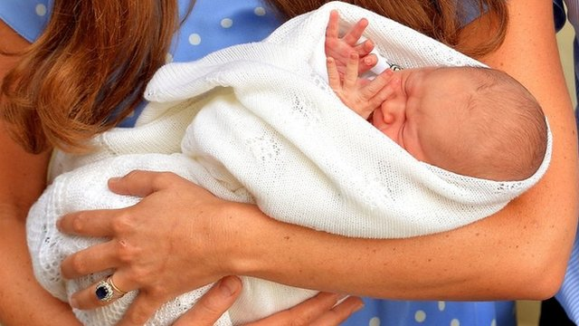 Prince George in his mother's arms
