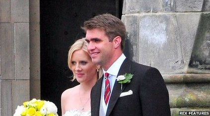 Oliver Baker seen with his wife on their wedding day