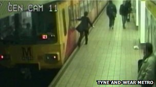 A passenger falls to the floor after trying to open a train door in Newcastle