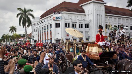Large crowds of people turned out to greet royal horse-drawn carriages which carried the couple to the royal palace