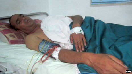 A wounded police officer receives the first treatment in a hospital in Sidi Bouzid on October 23, 2013