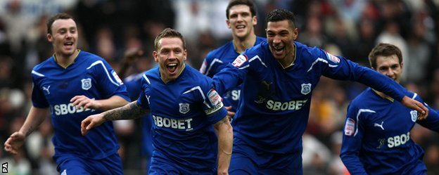 Craig Bellamy and team-mates celebrate