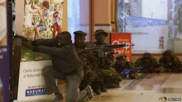 Soldiers and armed police hunt gunmen who went on a shooting spree in Westgate shopping centre in Nairobi, 21 September 2013