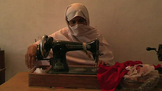 Meena sewing some clothes
