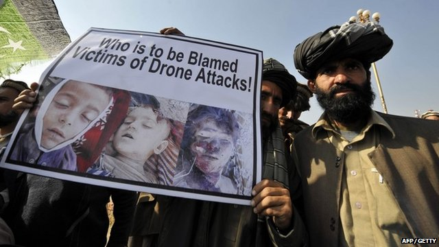 Pakistani tribesmen hold up a placard of alleged drone strike victims during a protest in Islamabad on February 25, 2012, against the US drone attacks in the Pakistani tribal region.