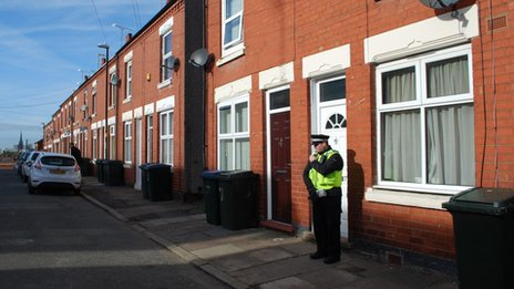 Police officer outside a house in Richmond Street, Coventry