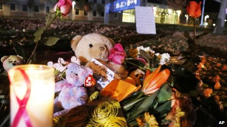 Candles and teddy bears are placed at Danvers High School prior to a candlelight vigil to mourn the death of Colleen Ritzer, a 24-year-old math teacher at Danvers High School on 23 October 2013