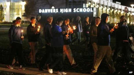 Parents and Danvers High School students hold a candlelight vigil to mourn the death of Colleen Ritzer in Danvers, Massachusetts, on 23 October 2013
