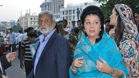 Members of the Vadodara royal family Sangramsingh Gaekwad (left) and wife Asha Raje Gaekwad (second on the right) arrive at a court in Vadodara on 23 October 2013