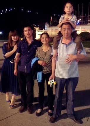Luo with his biological family
