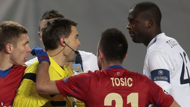 """Manchester City""""s Yaya Toure (r) speaks to the referee Ovidiu Hategan (l) during the Champions League match between CSKA Moscow and Manchester City"""
