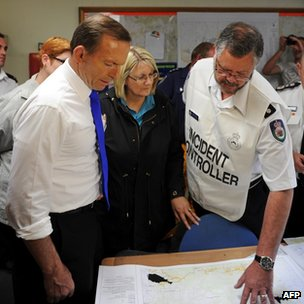 Prime Minister Tony Abbott receives a briefing at Winmalee fire station