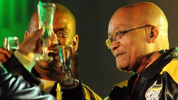 South Africa's President Jacob Zuma toasts at a street party in Johannesburg on 23 April 2009