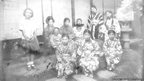 Women and children relaxing outside on a summer evening in the Tohoku region of Japan