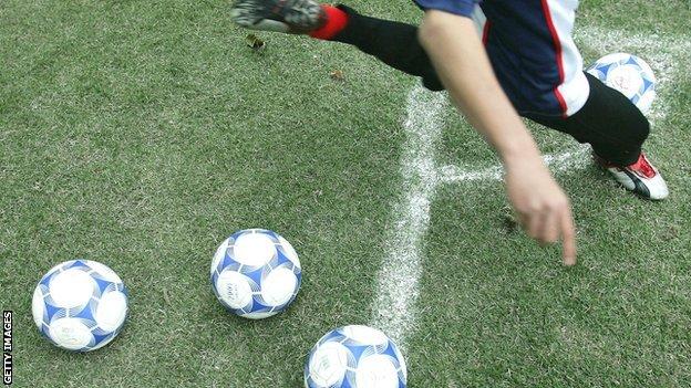 Footballer kicking a football
