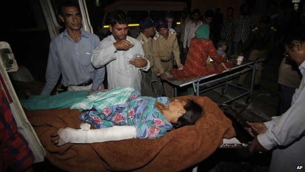 Indian villagers injured allegedly in firing by Pakistani troops across the India Pakistan border are brought on a stretcher for treatment at the government medical college hospital in Jammu, India, Thursday, Oct. 24, 2013