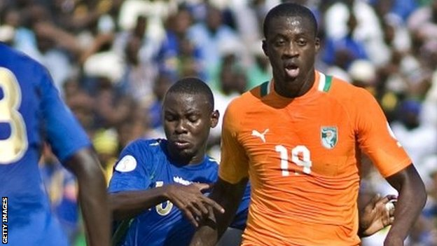 Yaya Toure (right) of Ivory Coast attempts to get past Frank Domayo and Nadir Haroub (left) of Tanzania