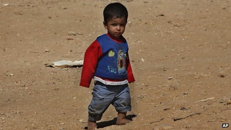 A Syrian child in a refugee camp
