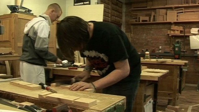 Adults taking wood work lessons