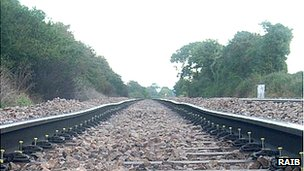 Railway track with cyclic top