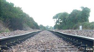 Railway track with cyclic top