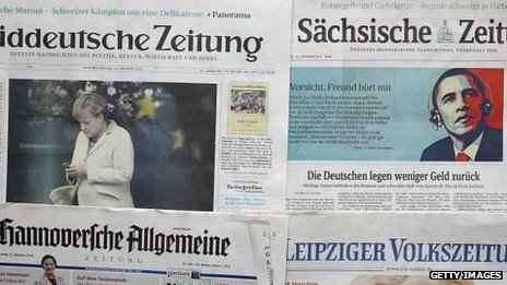 The front pages of German newspapers report the spying story