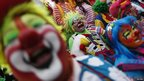 "Clowns laugh for fifteen minutes as rally for peace during 18th Latin American clown convention or ""Fair of laughter"" at Mother Monument in Mexico City"