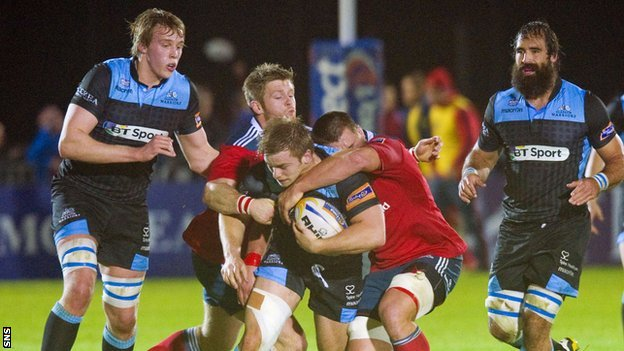 Pat MacArthur is closed down by Munster's CJ Stander and Ivan Dineen