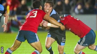 Glasgow captain Chris Cusiter is challenged by Munster's Casey Laulala and Mike Sherry (right)
