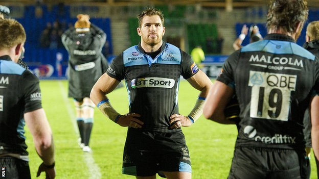 Glasgow Warriors are dejected after their defeat at home to Munster