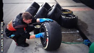 McLaren mechanic cleaning tyres