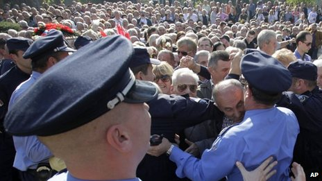 Serbian police hold back Tito supporters following the funeral of his widow Jovanka Broz, in Belgrade, Oct. 26