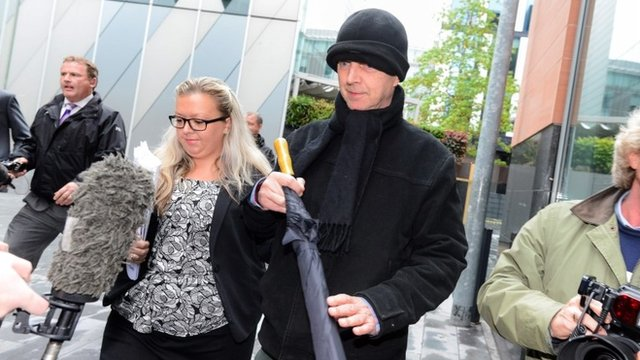 """Ray Teret (centre), 72, Jimmy Savile""""s former flatmate and chauffeur, leaves Manchester Magistrates Court"""