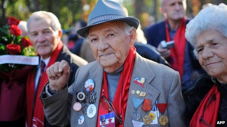 An admirer of the late Yugoslav Communist president Josip Broz Tito poses for a photograph in Belgrade on October 26, 2013