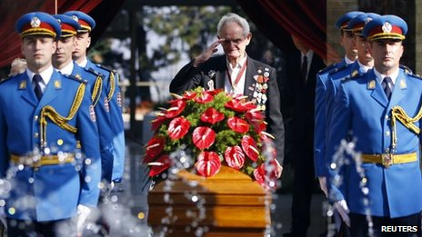 A World War II veteran salutes in Belgrade October 26,