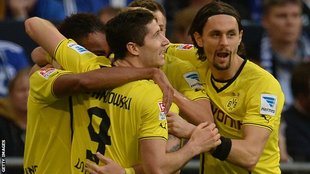 Borussia Dortmund players celebrate after scoring against Schalke