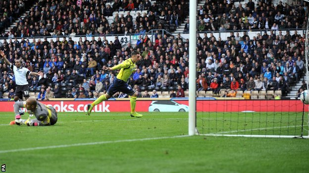 Birmingham's Lee Novak (centre) scores an equaliser at Derby