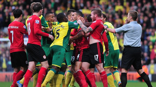 Norwich and Cardiff players argue