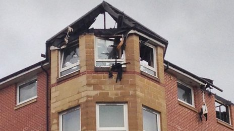 The fire left the roof of the building badly damaged