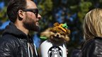 A dog dressed as a Pumpkin Spice Latte takes part in the 23rd annual Tompkins Square Halloween Dog Parade in New York October 26, 2013