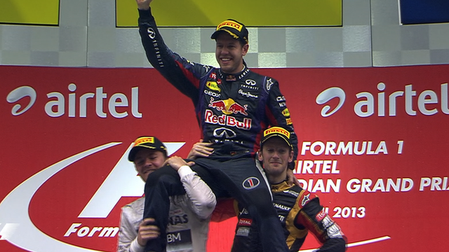 Sebastian Vettel raised aloft after winning Indian GP