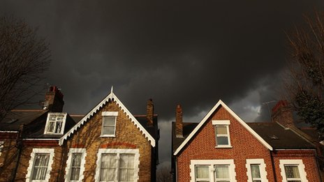 Storm clouds over rooftops in London (library image)