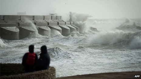 Waves crash against Brighton Marina on 27 October 2013