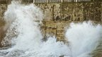 Waves hitting the harbour wall in Porthleven