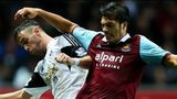 Alvaro Vazquez of Swansea in action against James Tomkins of West Ham