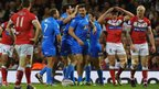 Aidan Guerra (c) celebrates after scoring Italy's opening try during the Rugby League World Cup group match against Wales at the Millennium Stadium